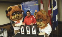 2014 NAIG mascots Buffalo and Young Buffalo alongside Stan Bobb, Chair of Community Development Corporation