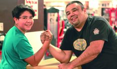 Young Cree arm-wrestlers take their place at the table