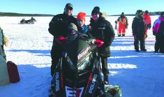 Snowmobile racing with Reggie and Trevor Bosum